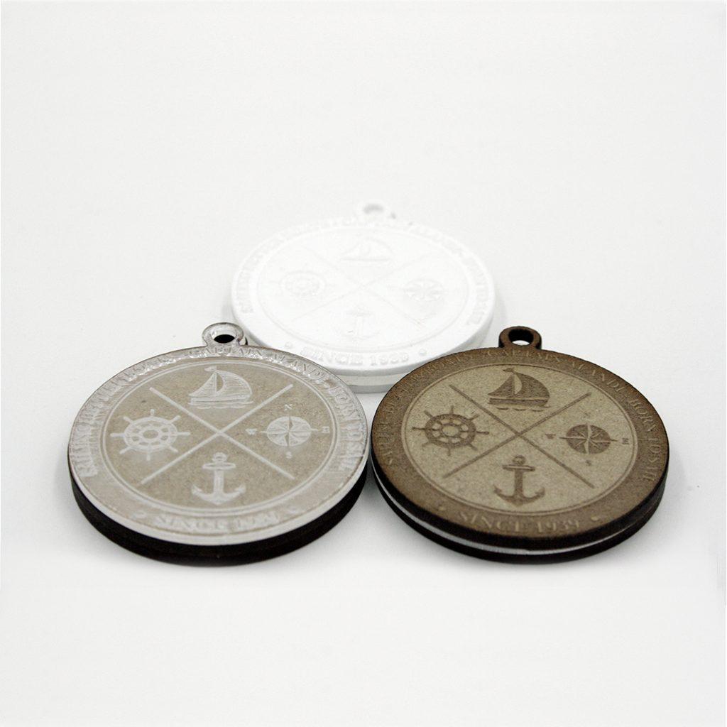 fabricación de llaveros archicercle mediante corte y grabado láser